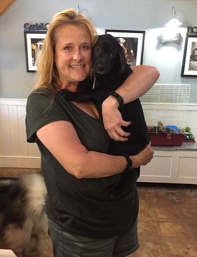 BCS Lead Event Planner Stacey Young with her puppy Harrison